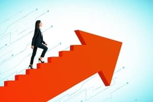 business woman walking up stairs resembling an arrow pointed upwards to illustrate her succeeding due to boosting self-awareness