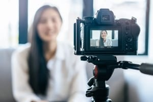 Woman recording herself for a remote virtual interview